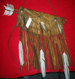 Aged leather quiver with deer bone knive